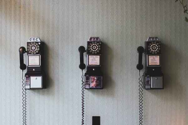 old telephones on a wall